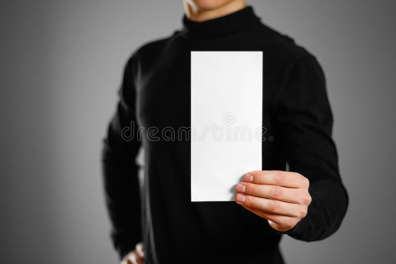 Man showing blank white flyer brochure booklet. Leaflet presenta. Tion. Pamphlet hold hands. Man show clear offset paper royalty free stock images