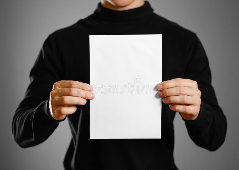 Man showing blank white flyer brochure booklet. Leaflet presenta. Tion. Pamphlet hold hands. Man show clear offset paper stock photo