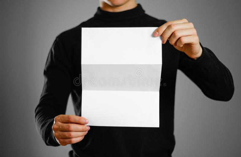 Man showing blank white flyer brochure booklet. Leaflet presenta. Tion. Pamphlet hold hands. Man show clear offset paper stock photos