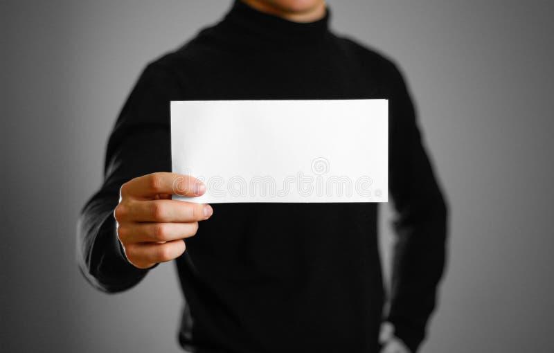 Man showing blank white flyer brochure booklet. Leaflet presenta. Tion. Pamphlet hold hands. Man show clear offset paper stock image