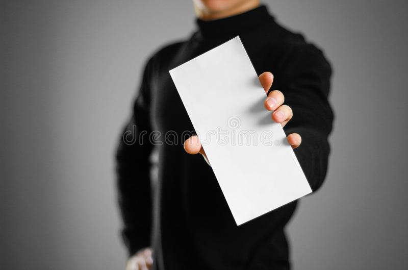 Man showing blank white flyer brochure booklet. Leaflet presenta. Tion. Pamphlet hold hands. Man show clear offset paper royalty free stock photography