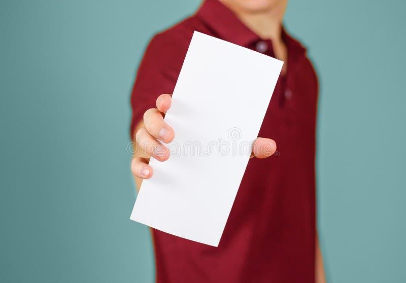 Man showing blank white flyer brochure booklet. Leaflet presentation. Pamphlet hold hands. Man show clear offset paper. Sheet template. Booklet design sheet royalty free stock photos