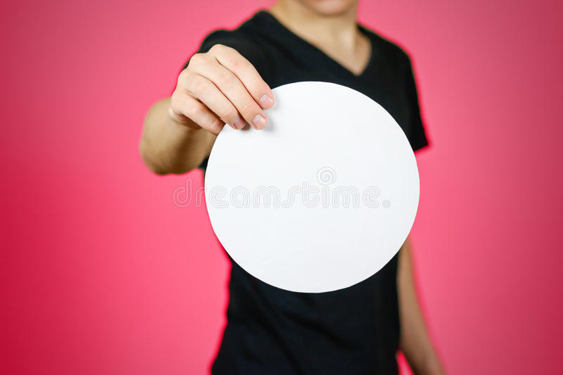 Man showing blank white rounded flyer brochure booklet. Leaflet. Presentation. Pamphlet hold hands. Man show clear offset paper. Sheet template. Booklet design royalty free stock photography