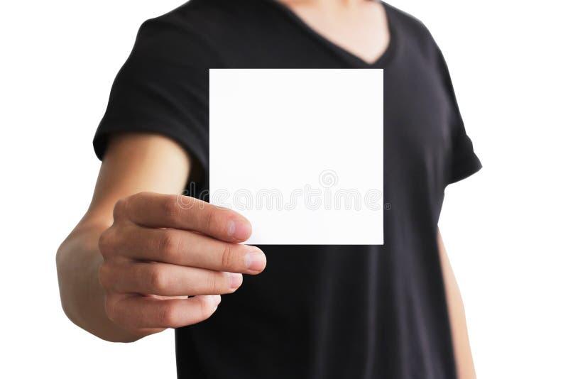 Man showing blank white square flyer brochure booklet. Leaflet p. Resentation. Pamphlet hold hands. Man show clear offset paper. Sheet template. Booklet design royalty free stock images