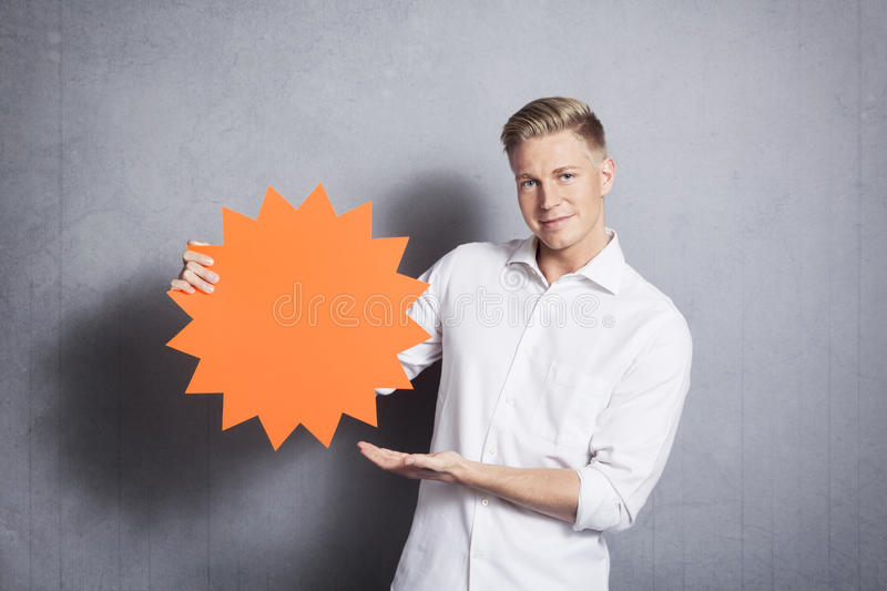 Man showing empty signboard with space for text. stock photography