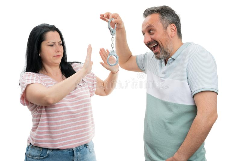 Man showing handcuffs to woman royalty free stock images