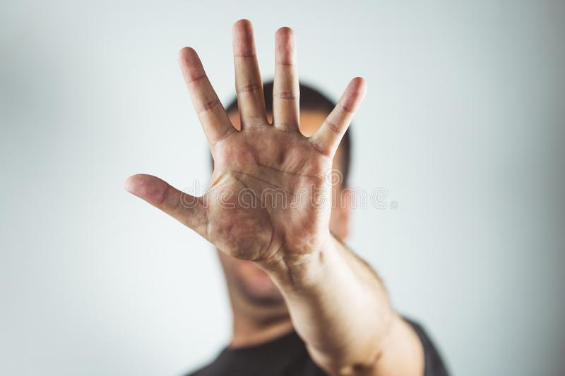 man showing hands and palm lines - Young man making stop gesture with his hand - concept of stop, strength stock photography
