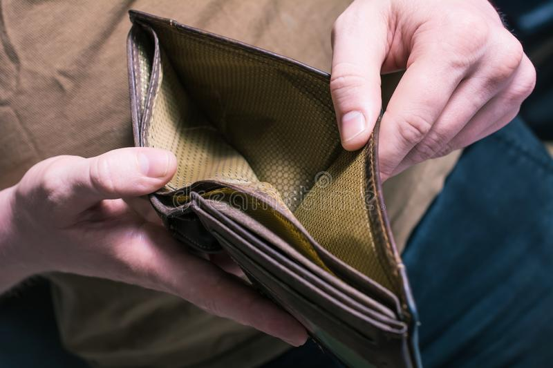 Man Showing His Empty Wallet - No Money Left Concept royalty free stock images