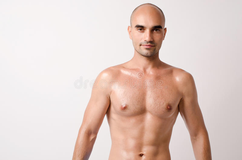 Man showing his fit body with six pack abs. royalty free stock images