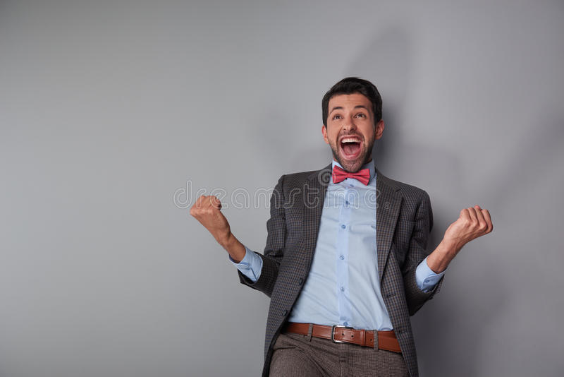 Man showing his happiness and success royalty free stock image