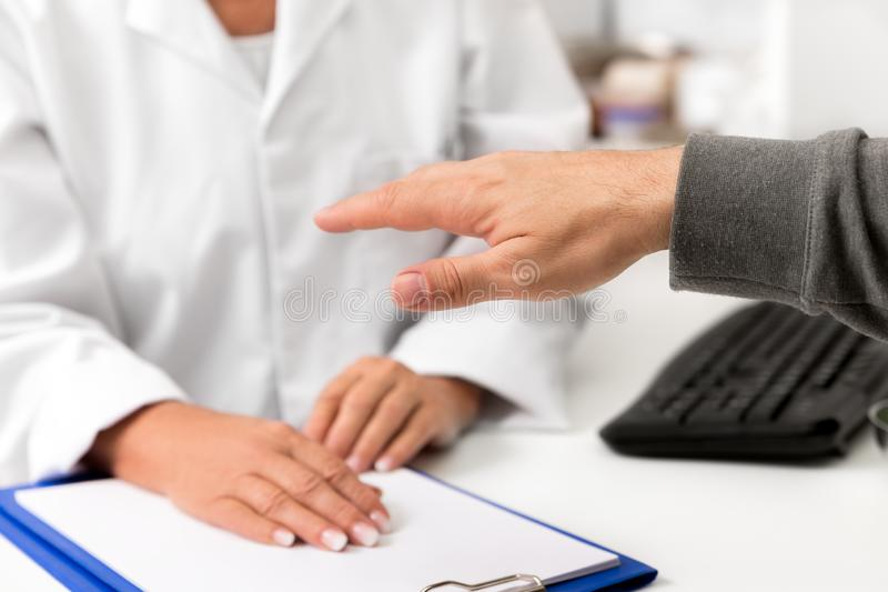 Man showing his tremulous hand on the clinic, concept tremor, parkinson and stress. Bodypart royalty free stock photo