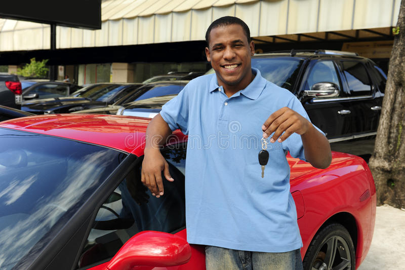 Download Man Showing Key Of New Red Sports Car Royalty Free Stock Photography - Image: 14582707