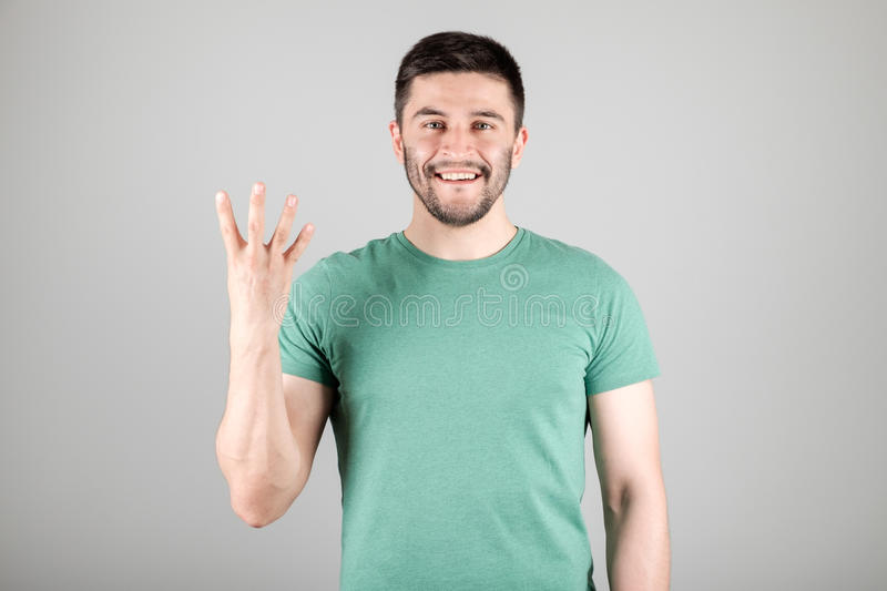 Man showing number by fingers stock photos