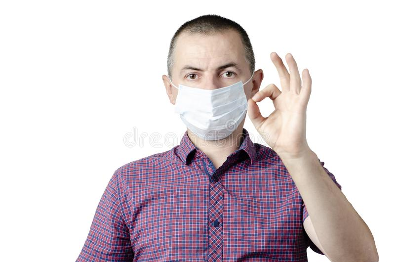 Man showing okay gesture. Photo of healthy man wears protective mask against infectious diseases and flu. Health care concept royalty free stock photos