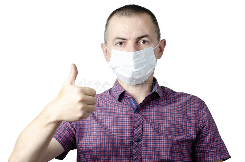 Man showing okay gesture. Photo of healthy man wears protective mask against infectious diseases and flu. Health care concept stock image