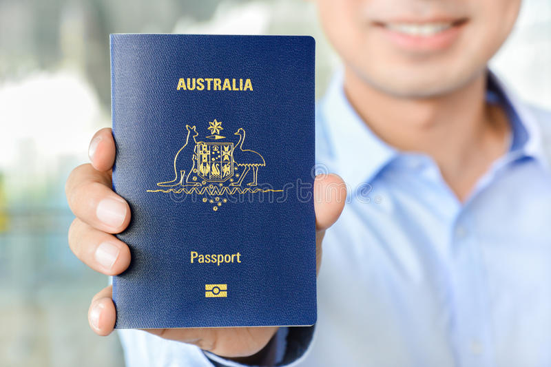 A man showing passport (of Australia) stock images