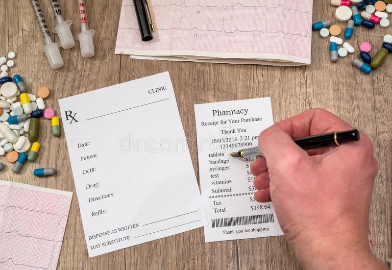 man showing on pharmacy receipt with rx blank, pills, syringe stock images
