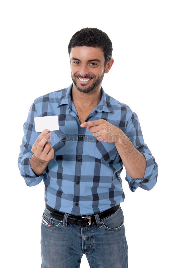 Man showing and pointing blank business card smiling happy stock photos
