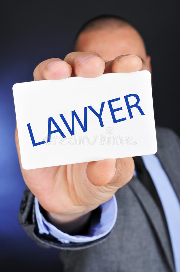 Man showing a signboard with the word lawyer royalty free stock photography