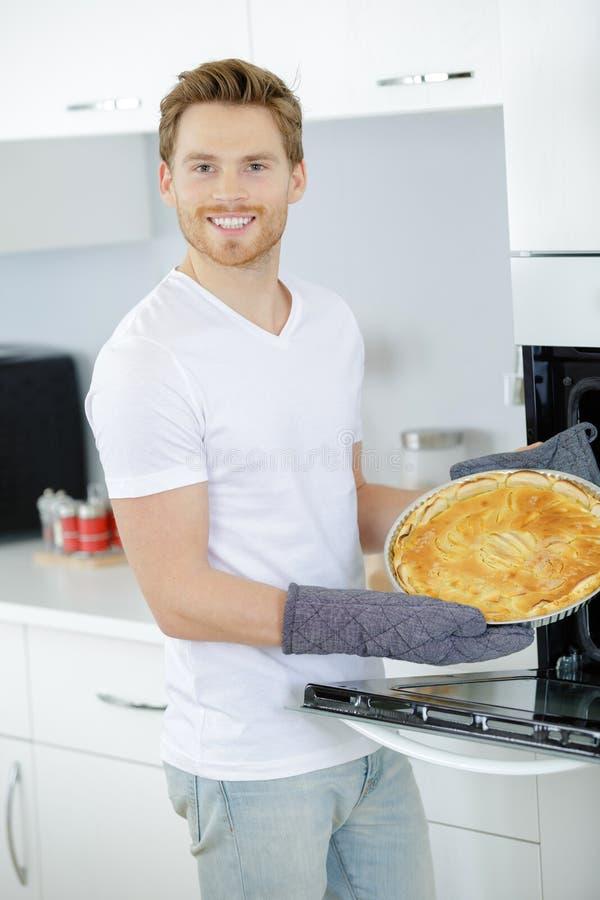 Man showing tart he has made stock photography