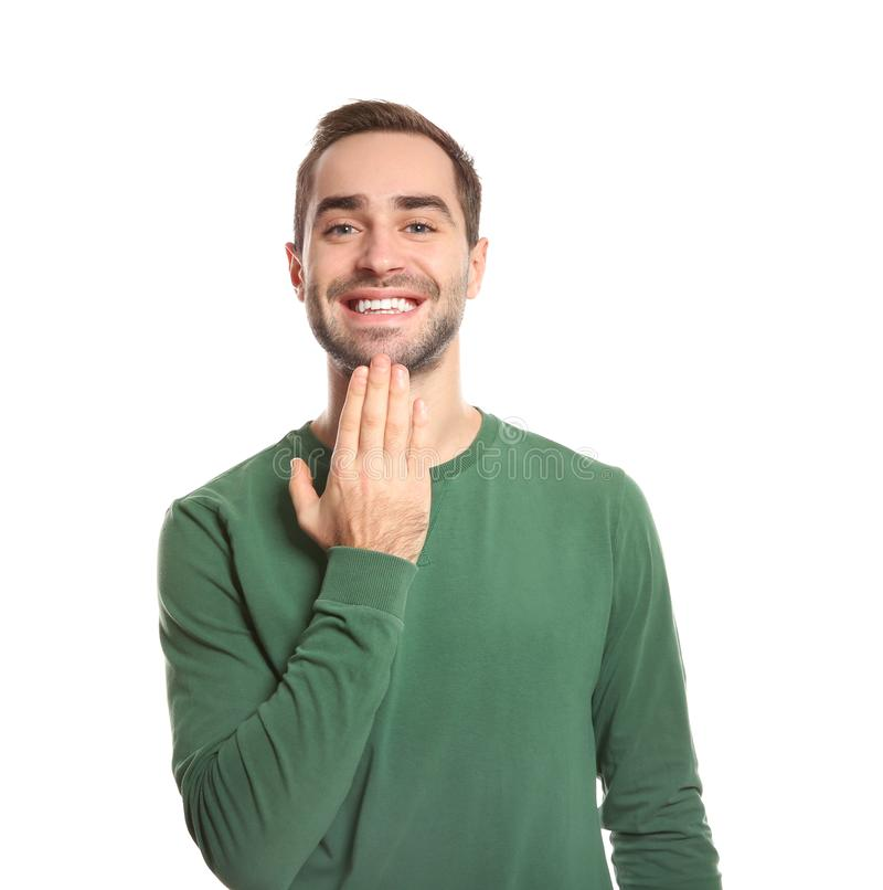 Man showing THANK YOU gesture in sign language on white. Background stock photos