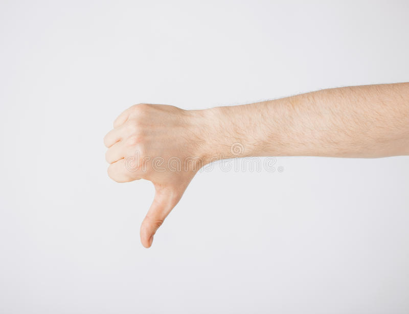 Man showing thumbs down stock image