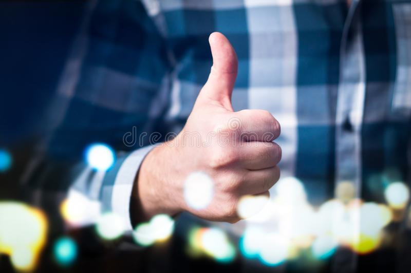 Man showing thumbs up in modern and abstract space. royalty free stock photography