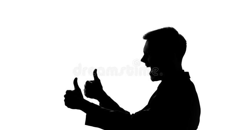 Man showing thumbs up, silhouette side view, celebration of successful startup stock images