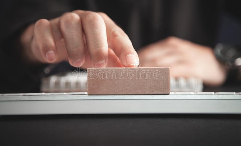Man showing wooden empty block royalty free stock photo