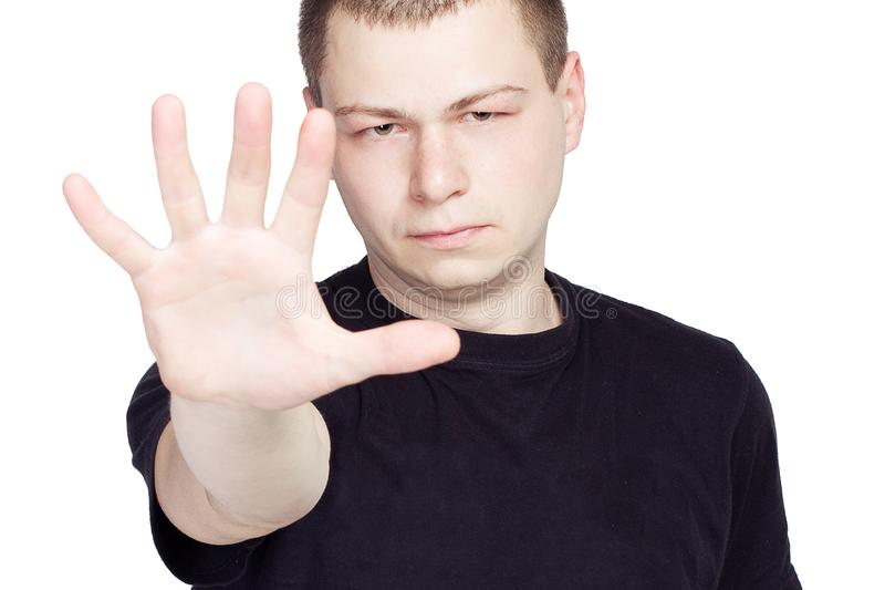 Man shows the hands stop on white background stock image