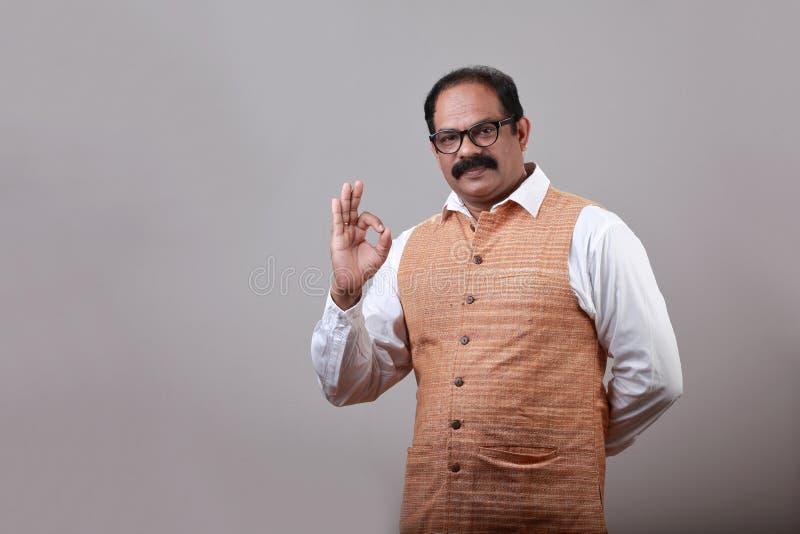 Man shows liking gesture. Man of Indian origin shows liking gesture stock photo