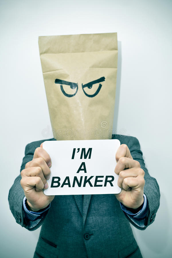 Man shows a signboard with the text I am a banker stock photography