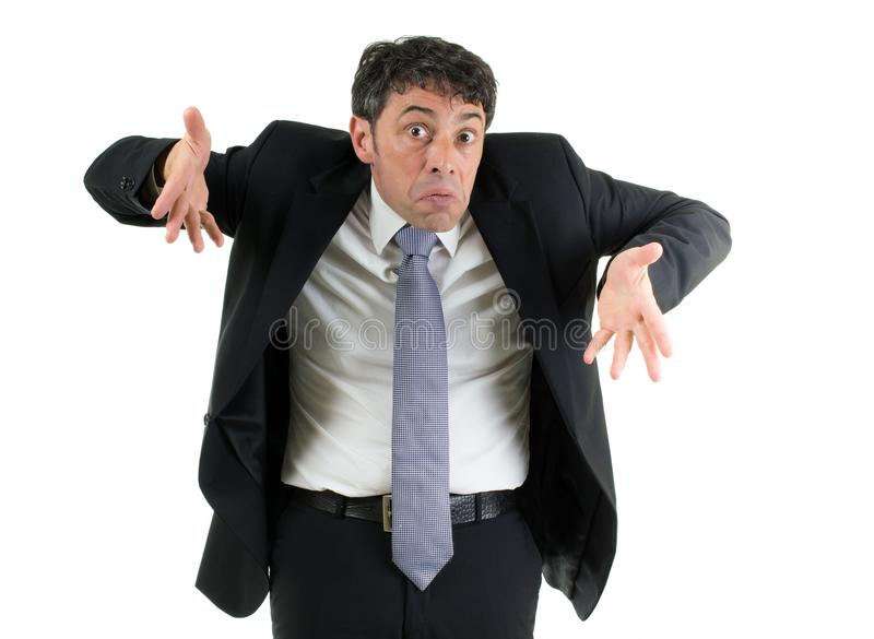 Man shrugging his shoulders. Expressive businessman shrugging his shoulders in ignorance or indifference and gesturing with his hands isolated on white royalty free stock image