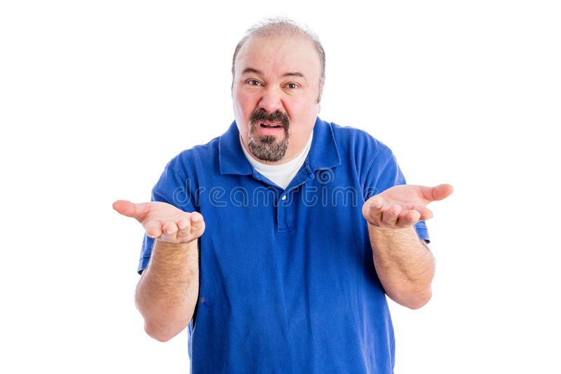 Man shrugging his shoulders and gesticulating. Middle-aged derisive man shrugging his shoulders and gesticulating as he shows his ignorance and disdain, isolated stock images
