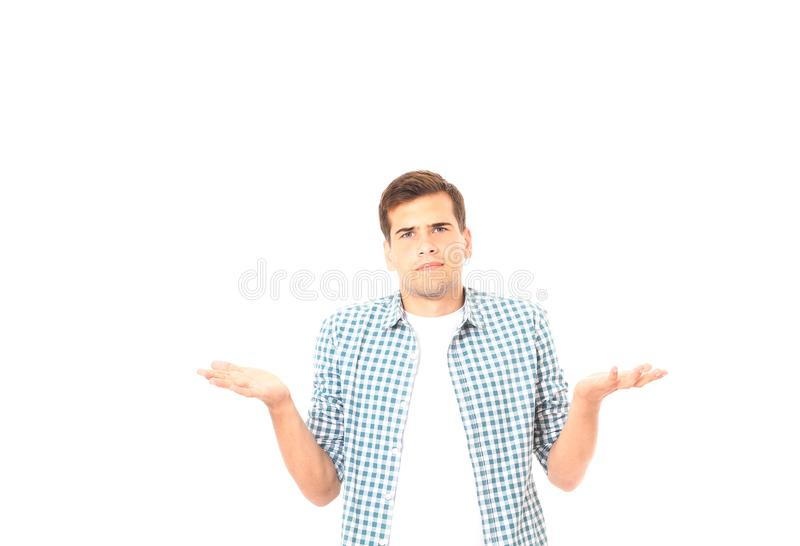 Man shrugs because of he doesn`t know what to buy. Isolated on white. Copy space. Mock up. Man shrugs because of he doesn`t know what to buy. Isolated on white royalty free stock images