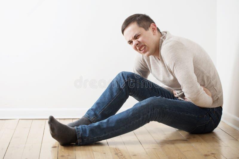 Man with a sick stomach. A man with a sick stomach stock photos