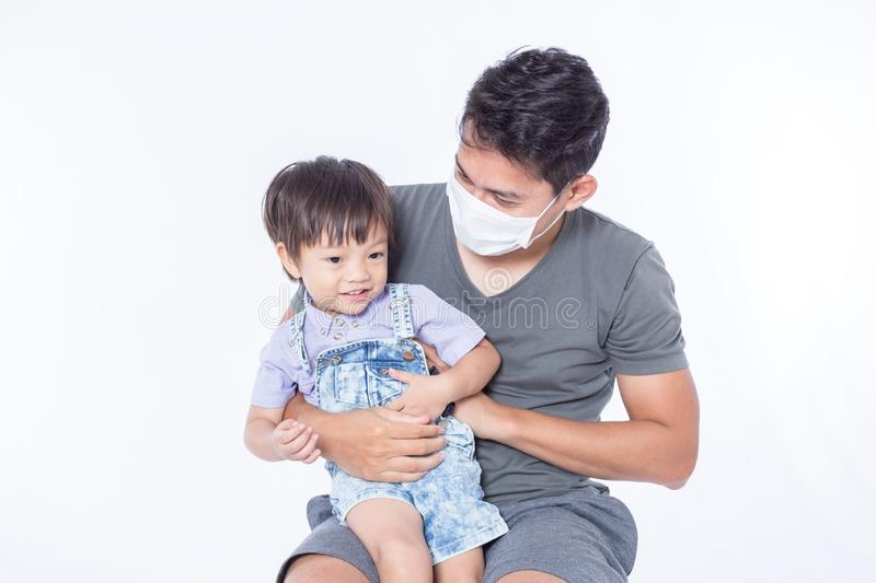 A man is sick and he wear hygienic mask for protect children get sick royalty free stock images