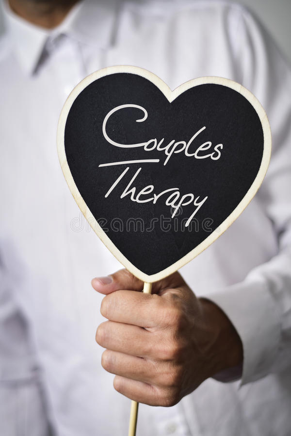 Man with signboard with text couples therapy stock image