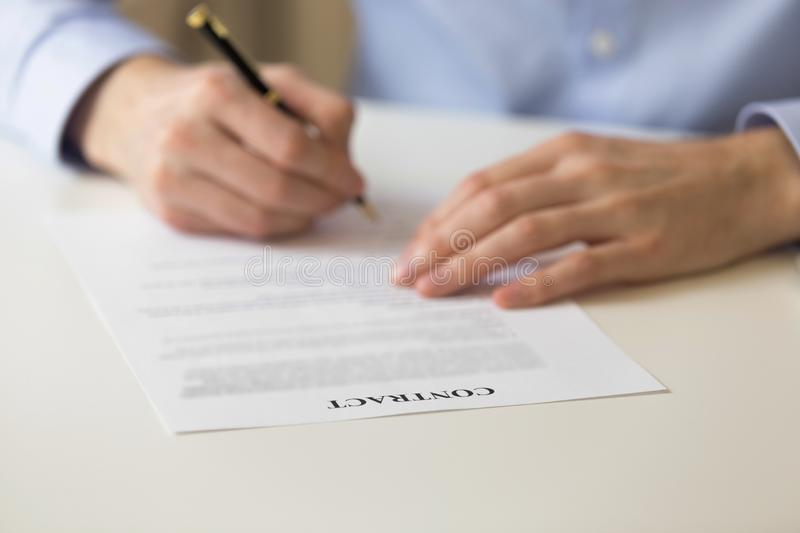Man signing contract close up hands and document stock image