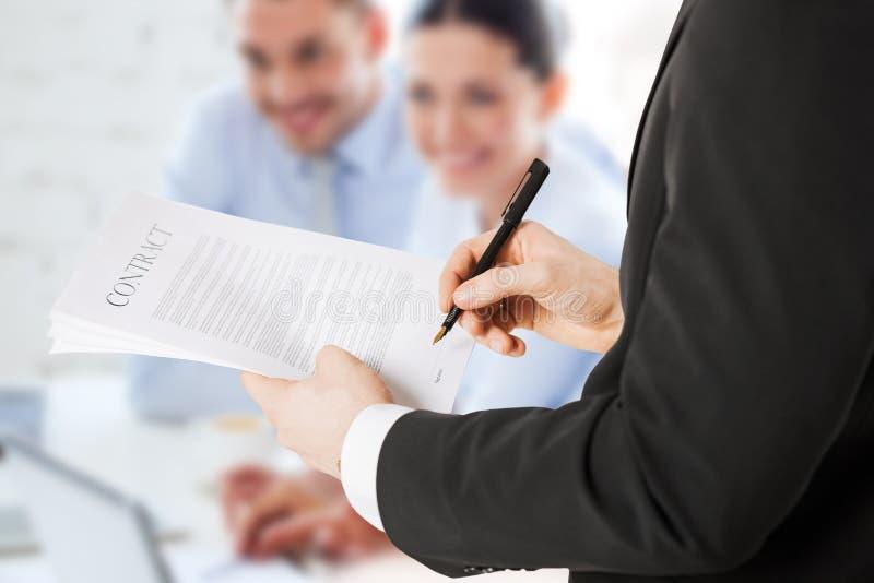 Man signing contract stock photos