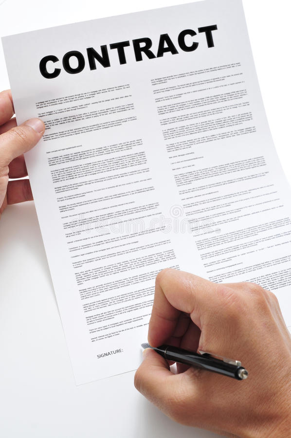 A man signing a contract royalty free stock photos