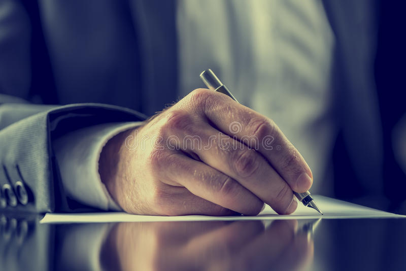 Download Man Signing A Document Or Writing Correspondence Stock Photo - Image: 38102446