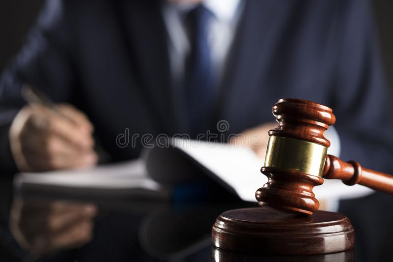 Counselor concept. Man signing documents. Gavel. Law concept stock image
