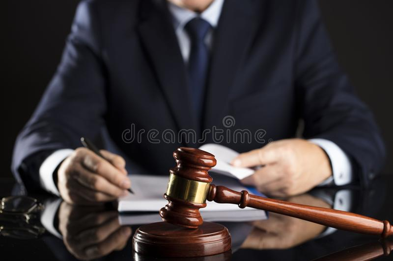 Counselor concept. Man signing documents. Gavel. Law concept stock photos