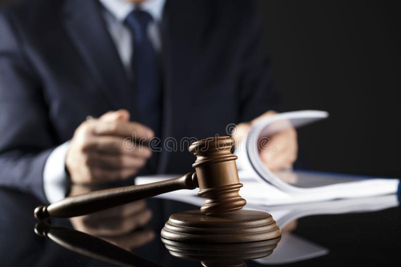 Counselor concept. Man signing documents. Gavel. Law concept stock photo