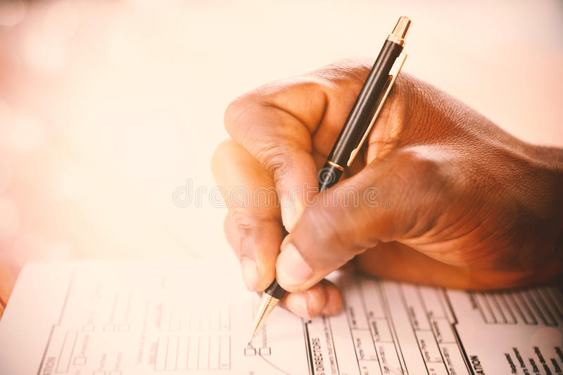 Man signing insurance document stock photography