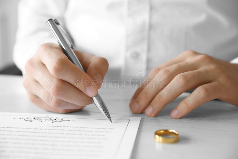 Man signing marriage contract stock photography