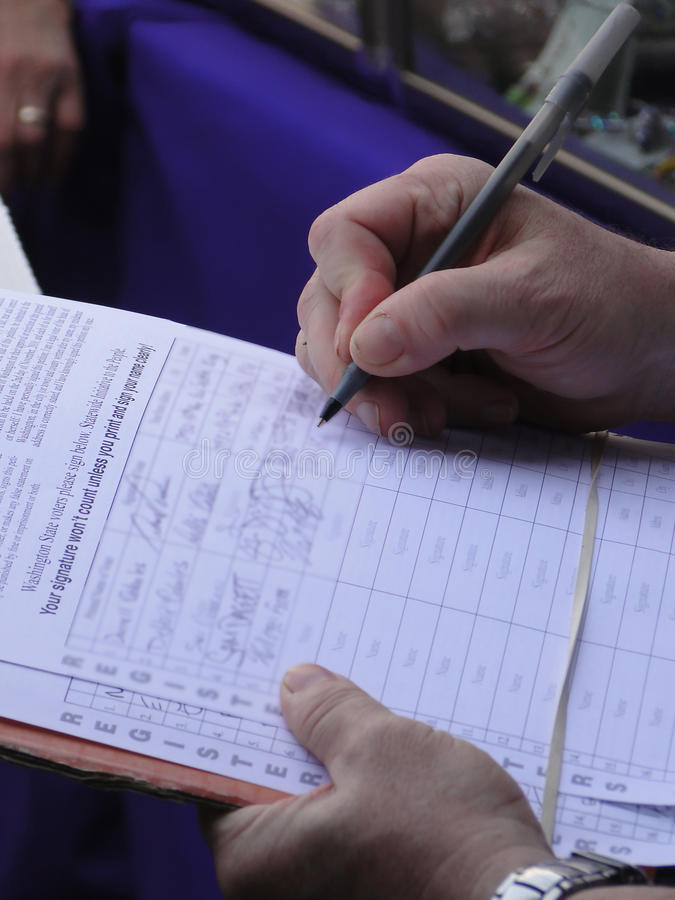 Man signing a petition. For a public referendum in Seattle royalty free stock photo