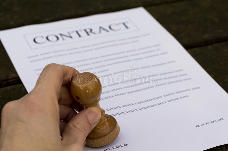 Man signs contract. A man hand signs and approves contract royalty free stock image