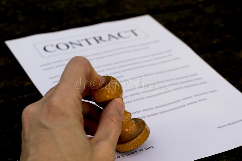 Man signs contract. A man hand signs and approves contract stock photos